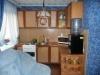 Трехкомнатная квартира у станции метро Заельцовская Кухонная зона Гостиная и кухонная зона объединена