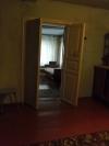 Двухэтажный дом из бревна в центре Колывани
