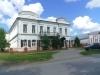 Двухэтажный дом из бревна в центре Колывани Музыкальная школа